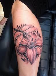 beautiful dragonfly n lily flower tattoo design