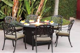 outdoor dining room decoration using round black granite top fire pit wrought iron outdoor dining table ideas including outdoor black iron dining chair