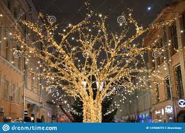 Gold Tree Lights Shining Gold Tree In Led Lights On The Backdrop Of The