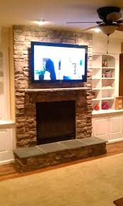 hanging tv over fireplace hang over fireplace where to put cable box wall mount stone interior