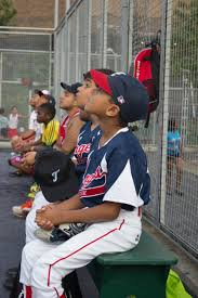 harlem home run upper inner city league photo essay olivia lace  the team gaze expectantly into the sky as a fellow little angels player hits a good