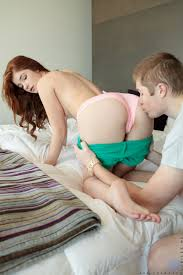 Pale redhead teen Ava Sparxxx gets stripped and fucked in her porn.