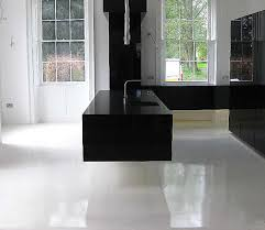 Resin Flooring Kitchen Ultra Modern Gloss Black Floating Cantilevered Kitchen With Pure