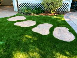 artificial turf yard. A Patch Of Artificial Turf With Large Round Stones Yard