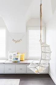 White Cottage Teen Girlu0027s Bedroom Features A White Rattan Chair Hanging  From A Rope Suspended From The Ceiling Placed Next To A Long Buu2026