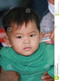 Aziatische Kinderen Van Een Jongen In Kapsel Stock Afbeelding