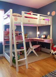 wood bunk bed with desk. White Wooden Bunk Bed With Pink Floating Desk And Ladder On The Floor Wood