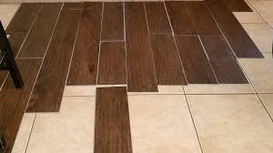 vinyl plank flooring over tile should this lay tiles installing ceramic kitchen l and stick laminate