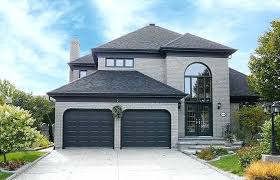 black and grey house after grey house white trim black shutters