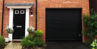 black garage doorRoller Garage Doors  Electric Roller Garage Doors  ABi Garage Doors