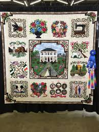 Dallas Quilt Show – Traditional Versus Artisan Quilts – Chopin – A ... & The quilt above was made by a woman who discovered her heritage through a  DNA test and it took 2 years to make this quilt that represents her  Heritage. Adamdwight.com