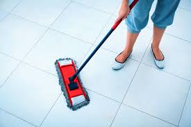 woman mopping floor best way to clean tile floors e b carpet