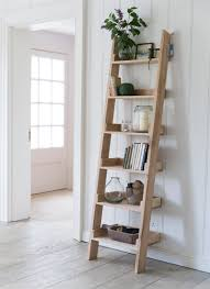amazing design ladder shelf ideas featuring natural brown color wooden ladder shelves and six display shelves and clear glass jar candle holder