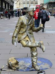 a rival golden man pictured in bath city centre living statues face unusual occupational hazards