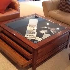 40 x 18 glass top 3 drawer display map coffee table residence as