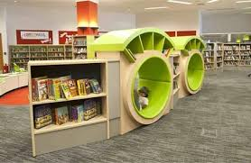 furniture for libraries. Library Shelving With 2 Circular Seating In The Middle That Have Been Designed To Look Like Furniture For Libraries