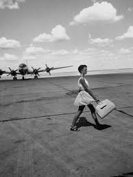 american airline hostess crossing field on way to jobs as a model and sales clerk at neiman marcus sales clerk jobs