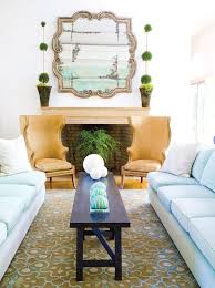 powder blue and gold living room with blue and brown rug
