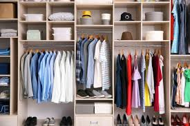 big wardrobe with diffe clothes for dressing room