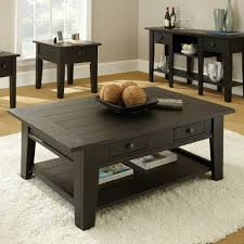 intresting extra large black square coffee table with storage for living room with white fur rug on wooden flooring idea