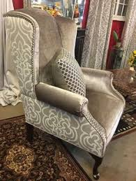 pair of custom upholstered wing back chairs available now