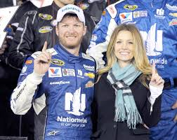 Wife Amy Reimann with her husband Dale Earnhardt Jr. at their wedding