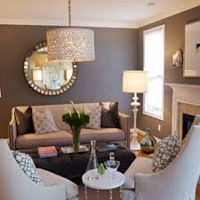 mid sized elegant medium tone wood floor living room photo in raleigh with brown walls on wall decor for traditional living room with living room wall ideas houzz