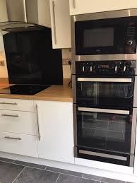 built in double oven also microwave and grill ceramic hob and warming drawer