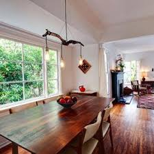 inspiration for a rustic dark wood floor dining room remodel in orange county with white walls