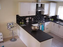white kitchen, black worktop and splash back