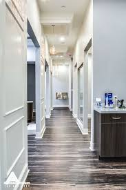Orthodontic Office Design Classy Paneled Hallways And Organic Light Fixtures Sky Grey Walls Darker