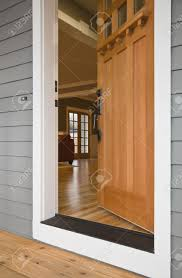 exterior view of the open front door to a residence with the interior viewable from the