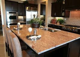 a large kitchen island covered in pink granite