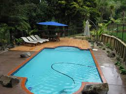 auckland landscaper kensington landscaping swimming pool feature timber deck and coloured