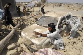 earthquake leaves dead forms new island com i survivors clear the debris of destroyed houses in the earthquake devastated district of awaran