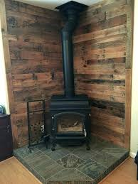 convert fireplace to wood stove converting a gas fireplace back to wood burning pallet wall behind convert fireplace to wood stove