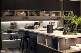 view in gallery kitchen island with open shelving and a small breakfast bar