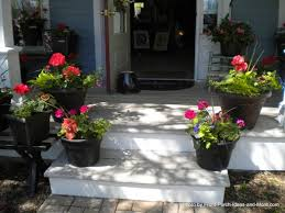 #springintothedream Front Porch Inspiration: Flowers on Porch Steps. Pretty  potted geraniums .