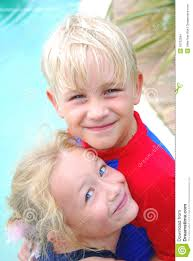 outdoor children portrait of a cute little caucasian boy and child with happy smiling expression in their faces enjoying their first