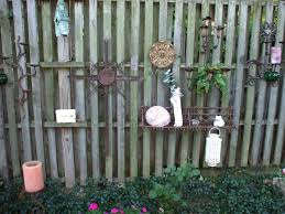 classic nuanced fence decor for contemporary patio which is decorated with vintage designed ornaments in colorful