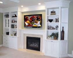 built in shelving tv over fireplace