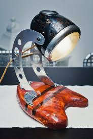 did you want to add a bookshelf to your moto lamp this one is metal wood and made from an old school harley headlight