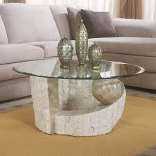 magnussen home ponte vedra stone and glass round coffee table
