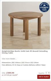 oak furniture land round dining table and chairs