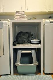ESpace chat, pour les petits logements - Small Laundry Room with litter box.  Not great- I would drop laundry into litter overflow between washer and  dryer.