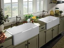 classic farmhouse kitchen design with painted kitchen cabinets and two farm sinks
