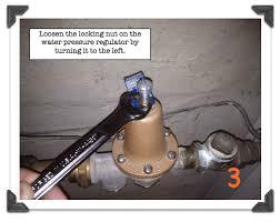 loosen the locking nut on the water pressure regulator