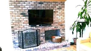 tv wall mount over brick fireplace mount