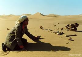 camel owner baoyin culu says prayers at the place where his last all of his 80 camels died from lack of grazing ground due to disappearing grasslands and desertification in