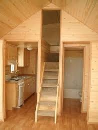Small Picture The Best Tiny House Build White appliances Wood stairs and